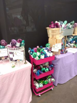 Indie dyed yarn on cart and table at fiber festival