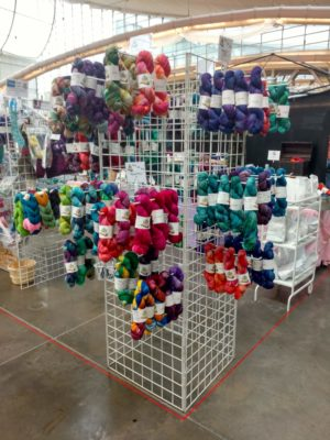 Indie dyed yarn hanging at a fiber festival