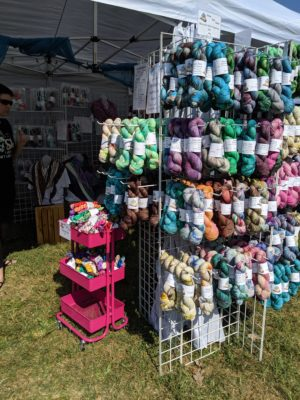 Indie dyed yarn hanging at an outdoor fiber festival