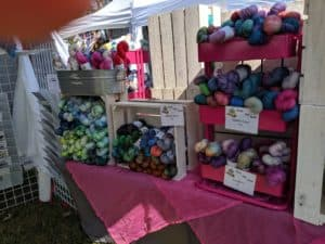 Hand Dyed yarn on table at fiber festival